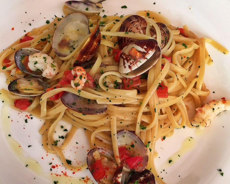 Handmade pasta with clams and tomato.