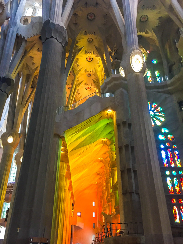 Stained glass rainbow light peeking through the windows